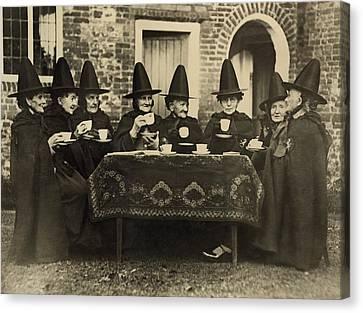 Eight Women In High Hats Having Tea Canvas Print by Everett