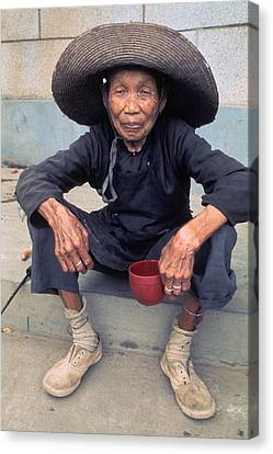 Elderly Begger Woman In China Canvas Print by Carl Purcell