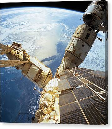 Elevated View Of A Space Station In Orbit Canvas Print by Stockbyte