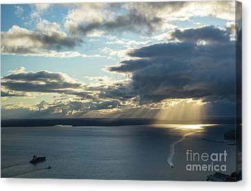 Elliot Bay Clouds And Sunrays Canvas Print by Mike Reid