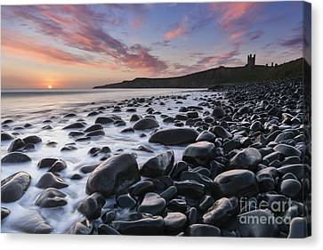 Embleton Bay And Dunstanburgh Castle At Dawn Canvas Print by Rod McLean