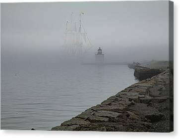 Canvas Print featuring the photograph Emerging From The Fog by Jeff Folger
