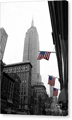 Empire State Building In The Mist Canvas Print by John Farnan