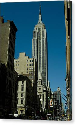 Empire State Building Seen From Street Canvas Print by Todd Gipstein