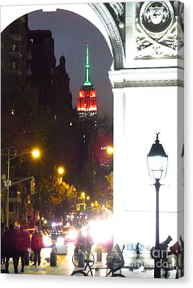 Empire State Building Through Wash Sq Arch New York Canvas Print by Ken Lerner