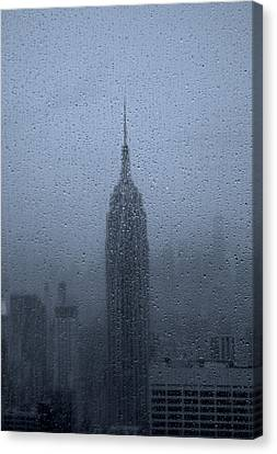Empire State In The Rain Canvas Print by Martin Newman