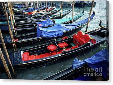 Empty Gondolas Floating On Narrow Canal Canvas Print by Sami Sarkis
