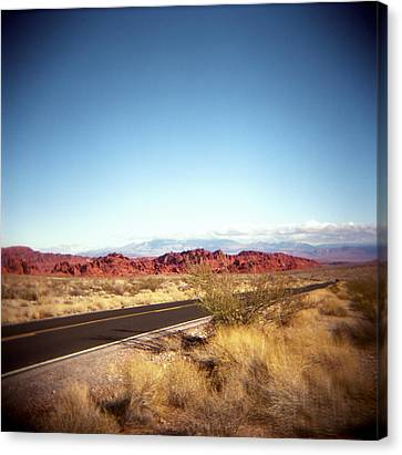 Entering The Valley Of Fire Canvas Print by Lori Andrews