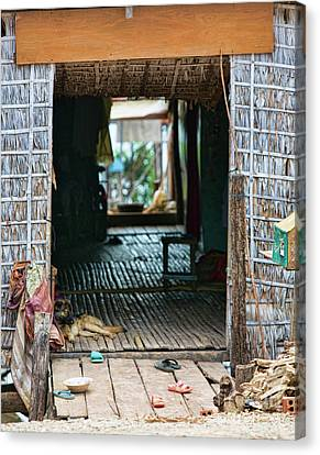Entrance To Tonle Sap Home  Canvas Print by Chuck Kuhn