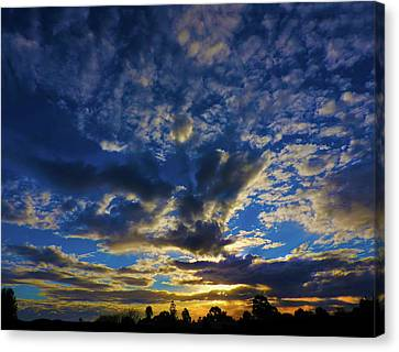 Canvas Print featuring the photograph Erupting Sunset by Mark Blauhoefer