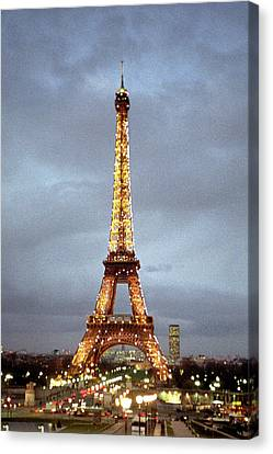 Evening At The Eiffel Tower Canvas Print by Mike McGlothlen