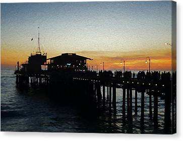 Evening On The Pier Canvas Print by Ernie Echols