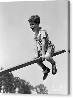 Excited Boy On Seesaw, C.1930-40s Canvas Print by H. Armstrong Roberts/ClassicStock