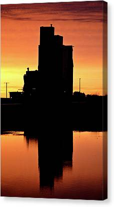 Eyebrow Gain Elevator Reflected Off Water After Sunset Canvas Print by Mark Duffy