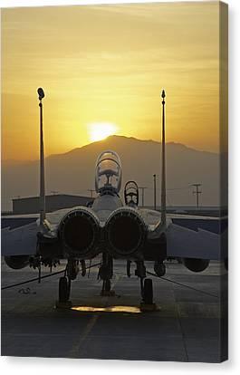 F-15e At Sunrise Canvas Print by Tim Grams
