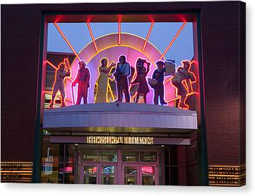 Facade Of A Museum Lit Up At Dusk Canvas Print by Panoramic Images
