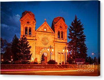 Facade Of Cathedral Basilica Of Saint Francis Of Assisi At Twilight- Santa Fe New Mexico Canvas Print by Silvio Ligutti