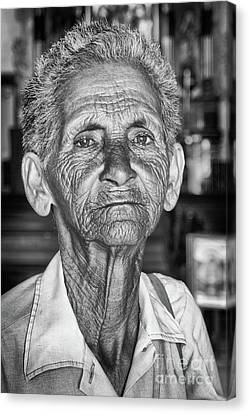 Faces Of Cuba The Woman In Need Canvas Print by Wayne Moran
