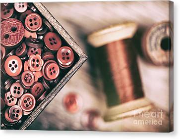 Faded Retro Styled Red Buttons And Thread Canvas Print by Jane Rix