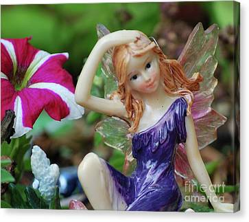 Canvas Print featuring the photograph Fairy In Flowerbed by Lila Fisher-Wenzel