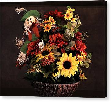 Canvas Print featuring the photograph Fall Flowers And Scarecrow by Sheila Brown