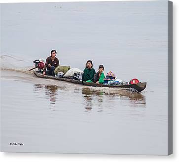 Family Boat On The Amazon Canvas Print by Allen Sheffield