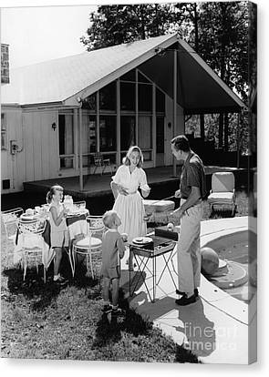 Family Grilling In Backyard, C.1950s Canvas Print by H. Armstrong Roberts/ClassicStock