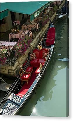 Fancy Gondola Parked In A Canal Next Canvas Print by Todd Gipstein