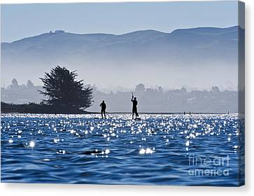 Faraway Paddle Boarders In Morro Bay Canvas Print by Bill Brennan - Printscapes