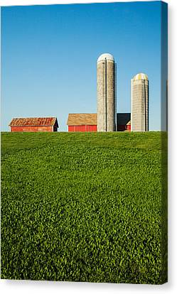 Farm Silos And Shed On Green And Against Blue Canvas Print by Todd Klassy