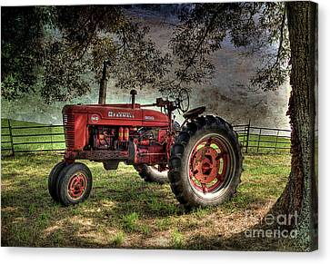 Farmall In The Field Canvas Print by Michael Eingle