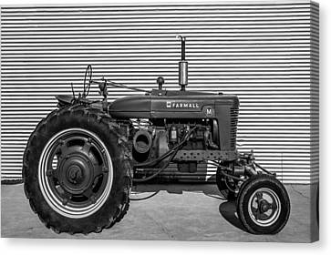 Farmall M And Steel Canvas Print by Todd Klassy