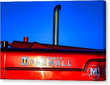 Farmall Sunset Canvas Print by Olivier Le Queinec