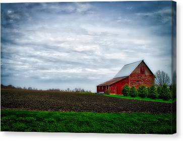 Farming Red Barn On A Quite Spring Day Canvas Print by Thomas Woolworth
