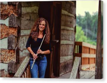 Female Flute Player At Log Cabin Canvas Print by Dan Friend