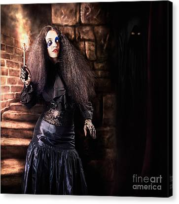 Female Jester Walking Inside Dark Castle Stairwell Canvas Print by Jorgo Photography - Wall Art Gallery