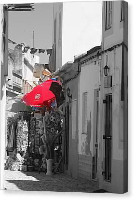 Canvas Print featuring the photograph Ferragudo Stall by Michael Canning