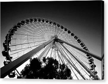 Ferris Wheel Canvas Print by Leslie Leda