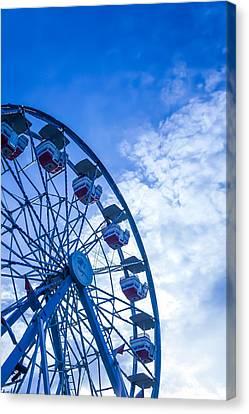 Ferris Wheel On Blue Sky Canvas Print by Art Spectrum