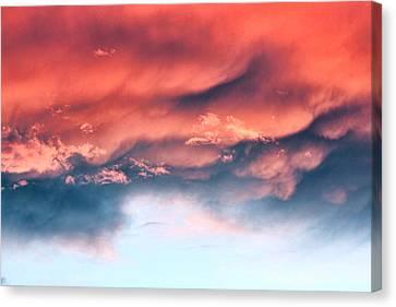 Fiery Storm Clouds Canvas Print by Tracie Kaska