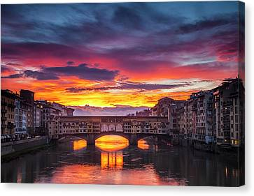 Fiery Sunrise Over Ponte Vecchio Canvas Print by Andrew Soundarajan