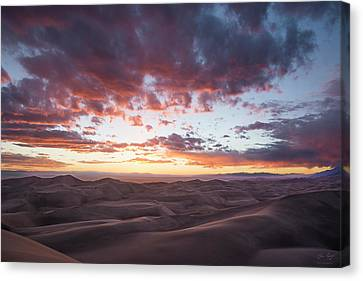 Fiery Sunset Over The Dunes Canvas Print by Aaron Spong