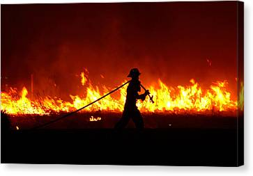 Fighting The Fire Canvas Print by Linda Unger