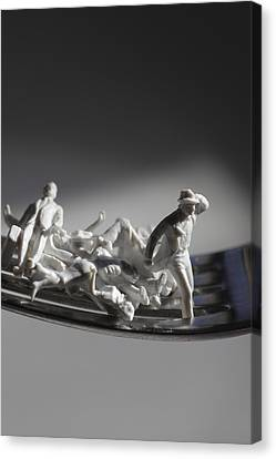 Figurines Trying To Escape From A Fork Canvas Print by Ulrich Kunst And Bettina Scheidulin