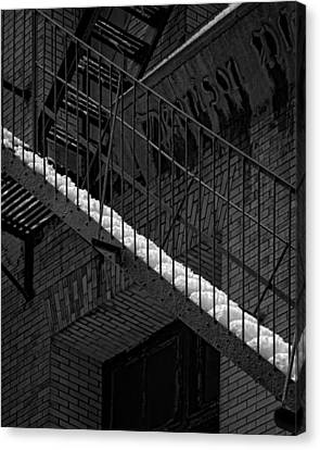 Fire Escape And Snow Canvas Print by Robert Ullmann