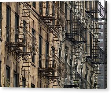 Fire Escapes On Brownstone Apartment Canvas Print by Everett