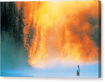 Fire Fly Fishing Canvas Print by Darwin Wiggett