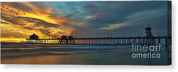 Fire On The Sky - Huntington Beach Pier Canvas Print by Peter Dang