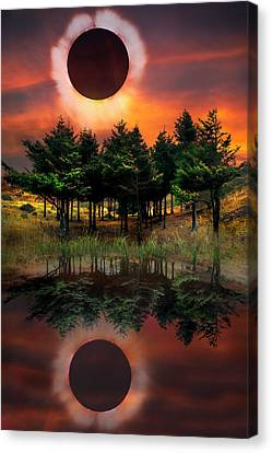 Firefall Eclipse Canvas Print by Debra and Dave Vanderlaan