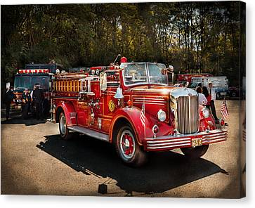 Fireman - The Procession  Canvas Print by Mike Savad